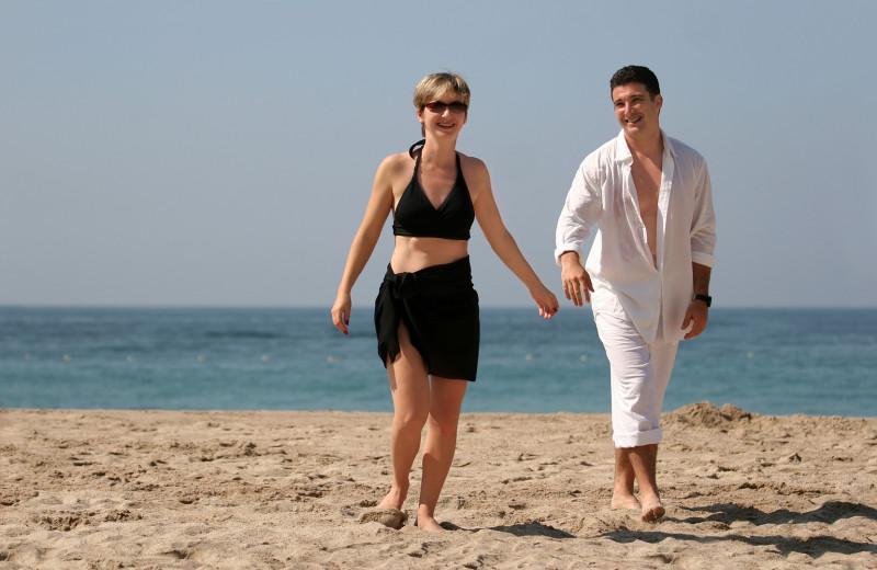 Couple on beach at Sanctuary Vacation Rentals at Sandbridge.