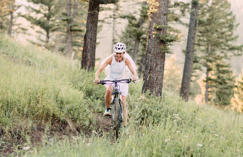 Bride biking at Hardscrabble Ranch.