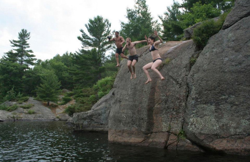 Jumping in the lake at Bob's Lake Cottages.