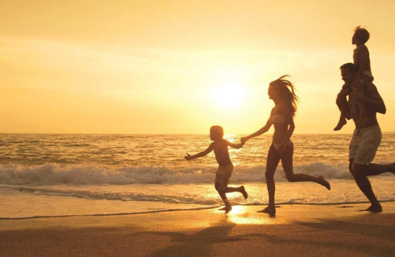Family on beach at Islander Hotel & Resort.