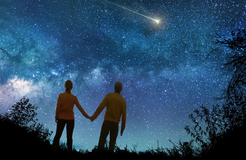 Couple watching stars at Hot Springs Village Rentals.