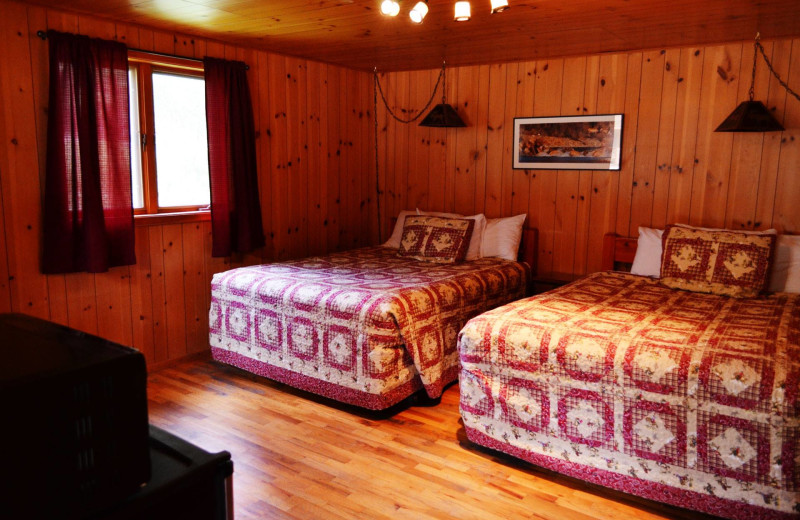 Cabin bedroom at Shoshone Lodge & Guest Ranch.