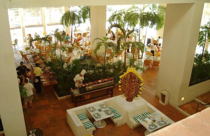 Dining at Raintrees Club Regina Cancun.