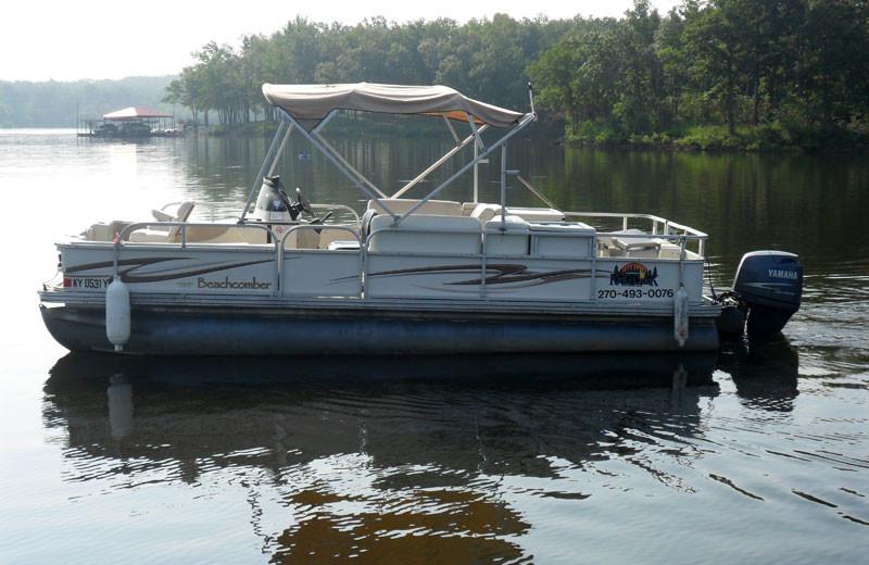Pontoon boat on King Creek bay at King Creek Resort & Marina.
