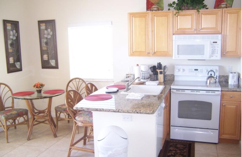 Unit kitchen and dining area at Boca Ciega Resort.