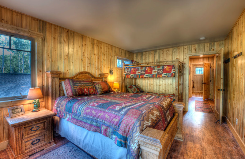 Cabin bedroom at Wild Skies Cabin Rentals.