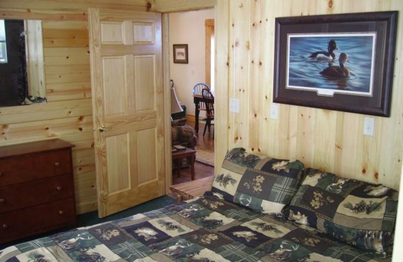 Cabin bedroom at Scenic Point Resort.