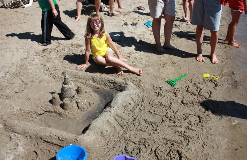 Building a sand castle on the beach at Finn'n Feather Resort.