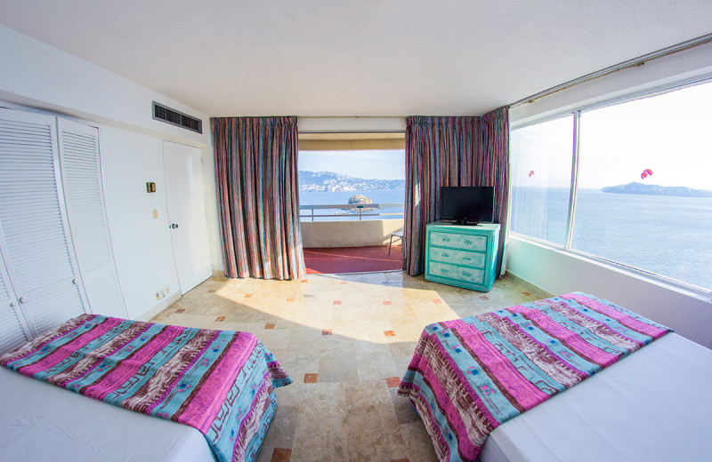 Guest room at Playa Suites Acapulco.