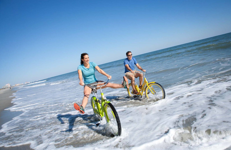 Riding bikes on the beach at Condo World.