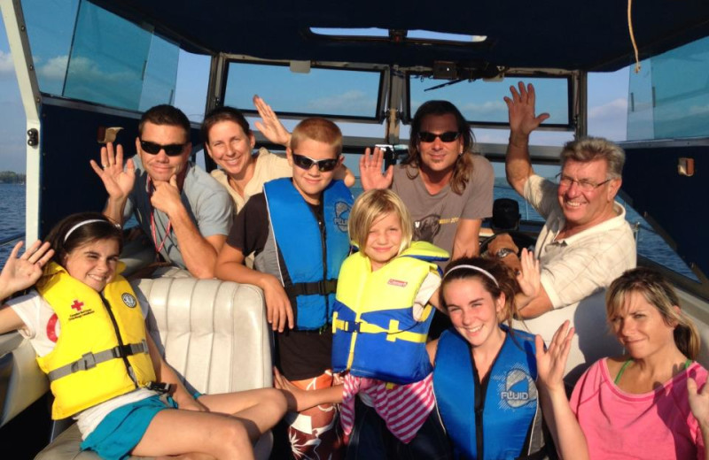 Family boating at Elmhirst's Resort.