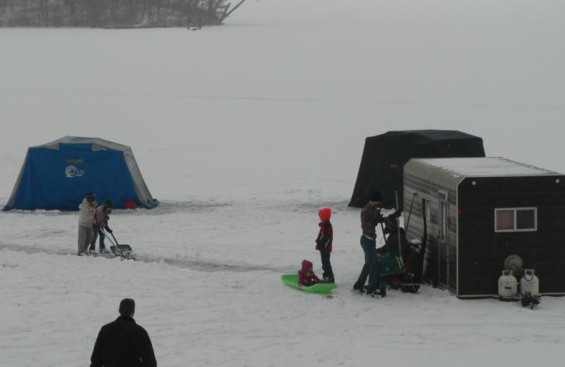 Ice fishing at Woodland Beach Resort.