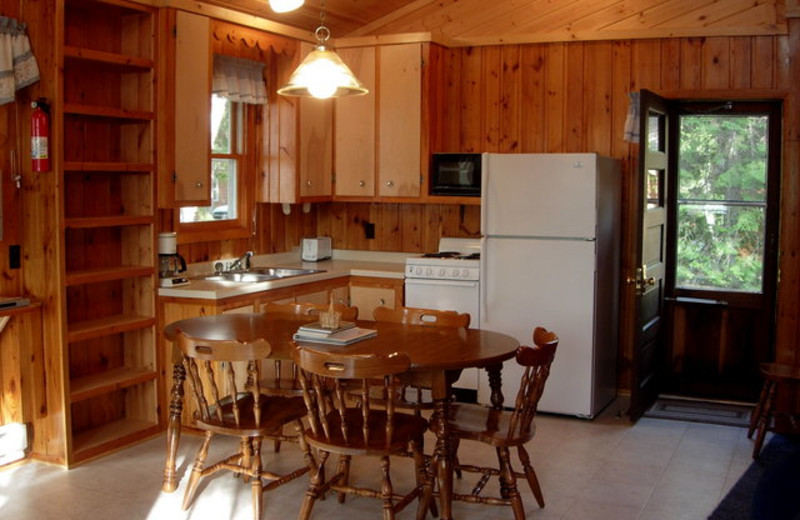 Cabin kitchen and dining area at Black Pine Beach Resort.