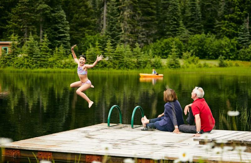 Kids jumping in lake at BCMH Bugaboos Lodge.