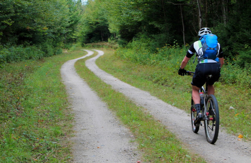 Cyclist trek miles of quiet remote scenic trails through Vermont's Great North Woods, also know as Vermont's Northeast Kingdom.