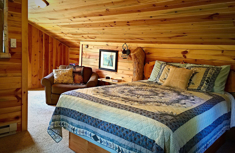 Cabin bedroom at Silver Mountain Resort and Cabins.
