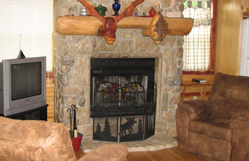Fireplace view at Can-U-Canoe Riverview Cabins.
