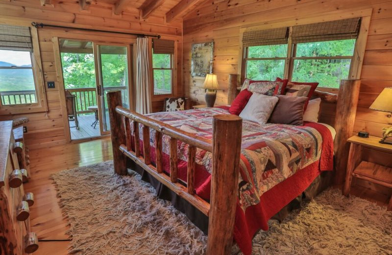 Rental bedroom at Blue Sky Cabin Rentals.