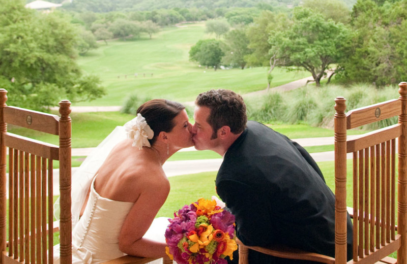 Couple kissing at Omni Barton Creek Resort & Spa.