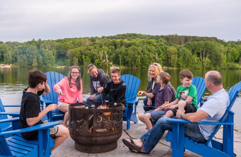 Family on dock at campfire at Deerhurst Resort