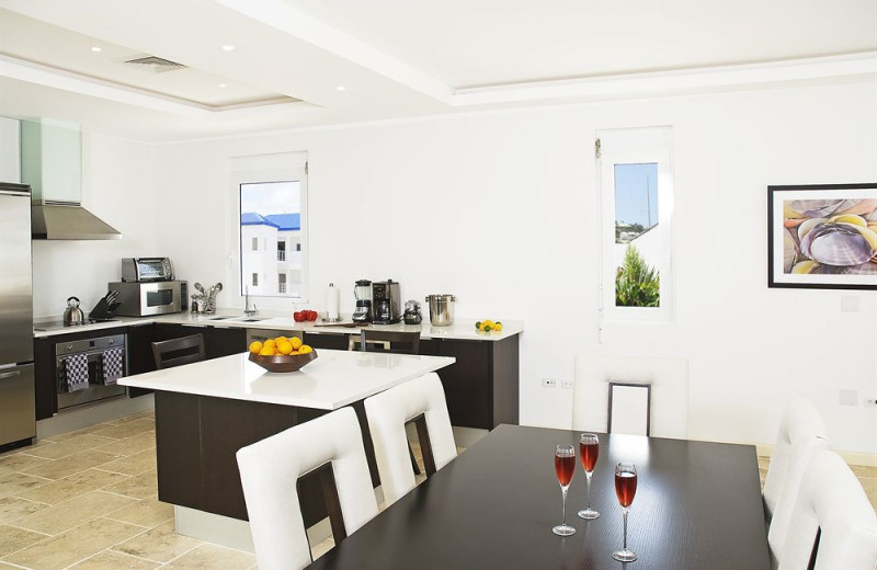 Vacation rental kitchen and dining room at Coral Beach Club.