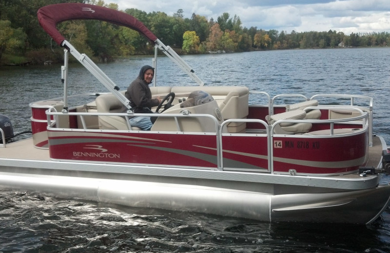 Boating at Breezy Point Resort on Straight Lake.