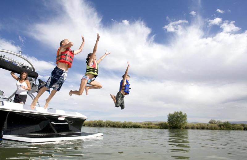 Family jumping into lake at Buffalo Point Resort.