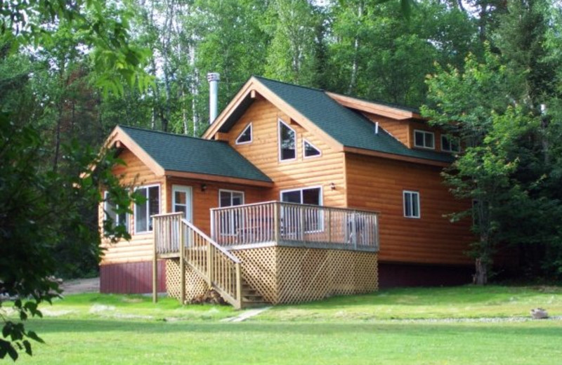 Chickadee cabin exterior showing two levels and deck area.
