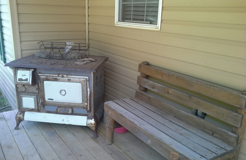 Grill and bench at American Pines Cabins.