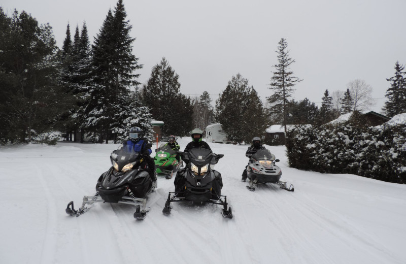 Snowmobiling at Owls Nest Lodge.