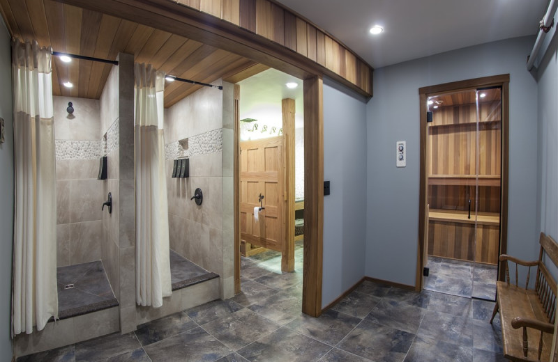 Fitness Center Locker Room Featuring 2 Showers and a Sauna