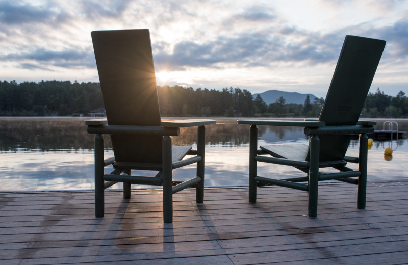 Grab a seat and watch the sunrise over Mirror Lake