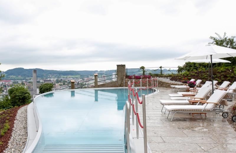 Outdoor pool at Hotel Schloss Mönchstein.