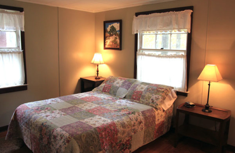Cottage bedroom at Phoenicia Lodge.