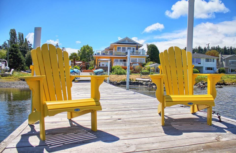 Chairs on a dock at Birds of a Feather Victoria Ocean-front B&B.