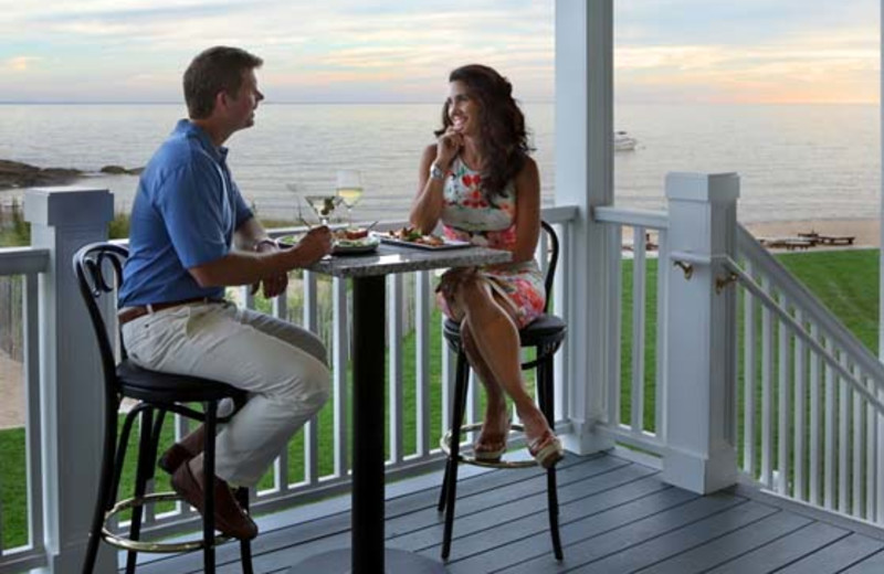 Couple dining on the deck at Madison Beach Hotel.