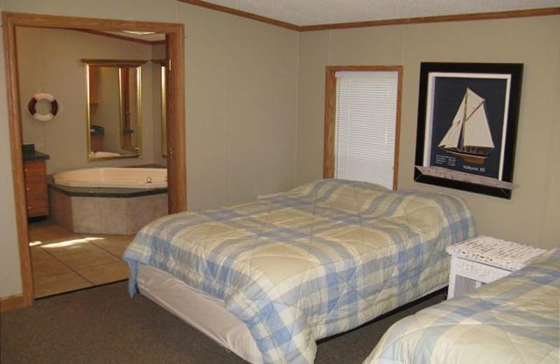 Vacation rental bedroom at Island Club Rentals.