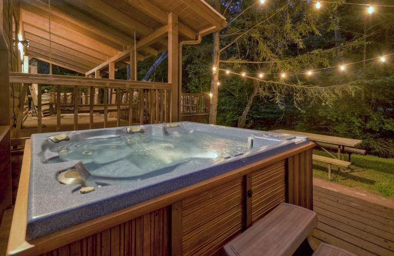Rental hot tub at Blue Sky Cabin Rentals.