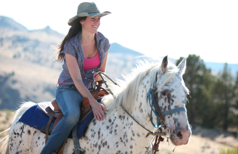 Woman horseback riding at Kah-Nee-Ta Resort and Spa.