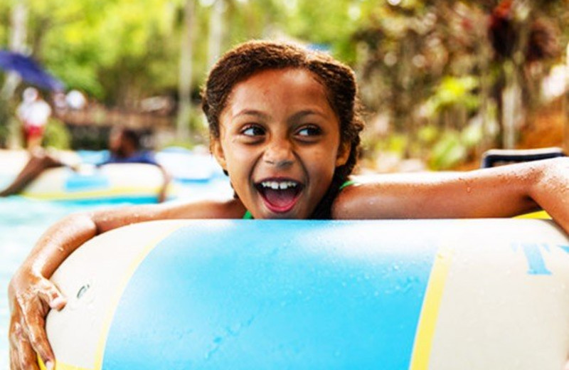 Kid in tube at Westgate Lakes Resort & Spa.