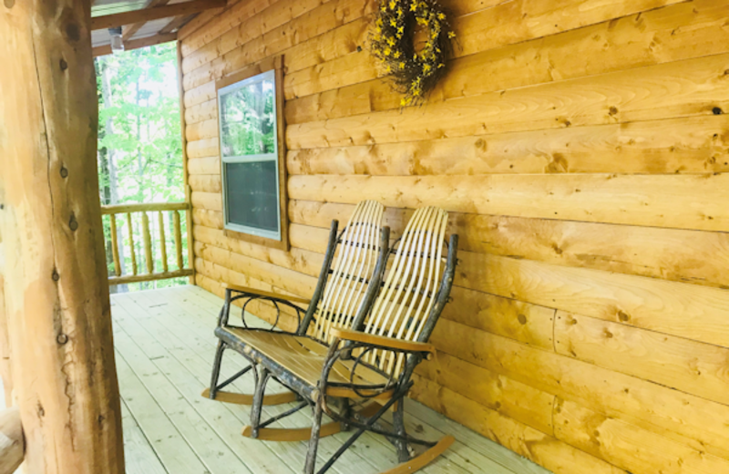 Rock your cares away on the Front Deck with beautiful wooden porch furniture and the privacy of being nearly surrounded by woodlands.
