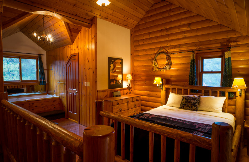Cabin bedroom at Baker Creek Mountain Resort.