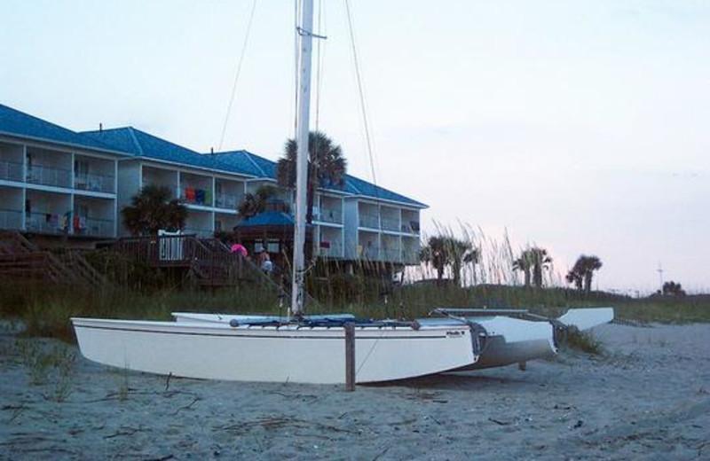 Boats on beach at Ocean Isle Inn.