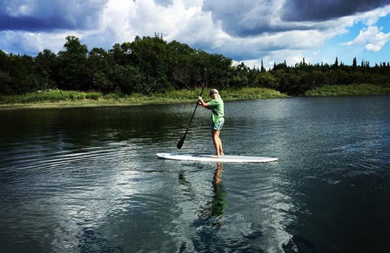 Paddle board at Alaska's Gold Creek Lodge.