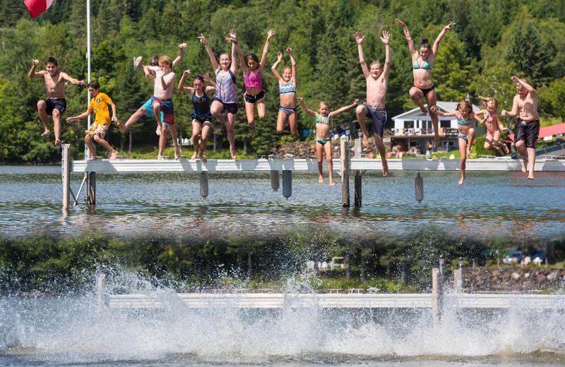Kids safely enjoy frolic at Jackson's Lodge beach and docks on pristine international Wallace Pond.