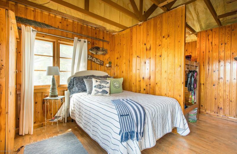 Cabin bedroom at Sybil Shores Resort.