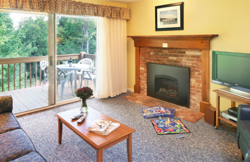 Fireplace and private porch at Summit Resort.