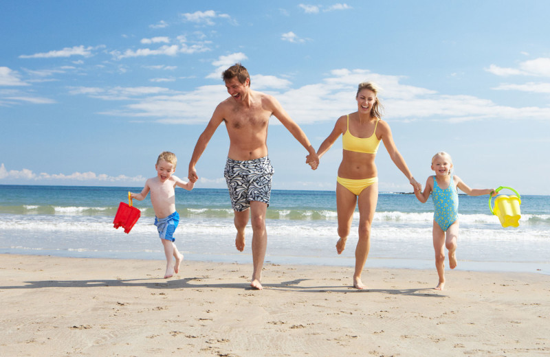 Family on beach at Seabreeze I.