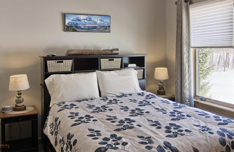 Cottage bedroom at Hawk's Eye Golf Resort.