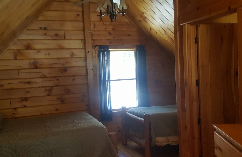 Cabin bedroom at The Birches Resort.